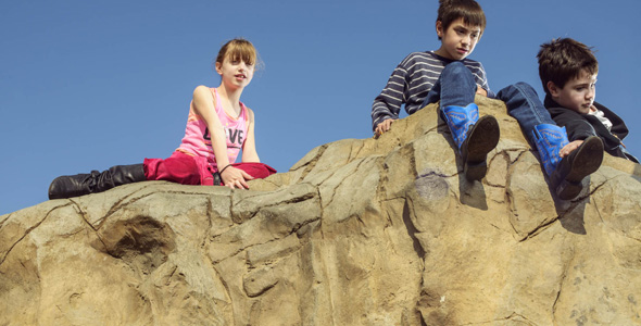 D'Arcy, John and Ian hang out on top of the big climbing rock at Kidd Springs Park. Getting up there is easy enough, says D'Arcy, but climbing down is a little scary. Photo by Danny Fulgencio