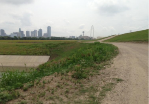 An example of the existing maintenance road alongside the Trinity that would double as a trail.