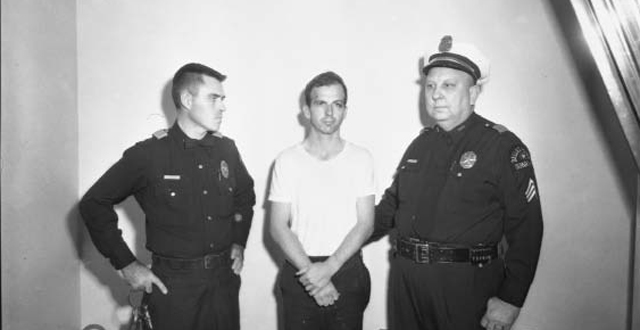 """Presumed presidential assassin and one-time Oak Cliff resident Lee Harvey Oswald, photographed at the Dallas police headquarters before an interrogation. This is one of the photos from a new book by John H. Slate and Mark Doty, """"John F. Kennedy Sites in Dallas-Fort Worth,"""" due out Sept. 2: Dallas Municipal Archives."""