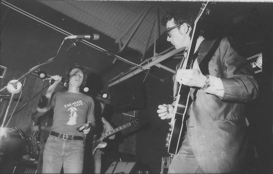 Elvis Costello, right, jams with Delbert McClinton at the Old Warehouse in Dallas, 1978: Kirby Warnock
