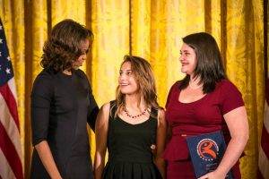 First Lady Michelle Obama, Adamson HIgh School student Emily Sanchez and Project Discovery teacher Rachel Hull