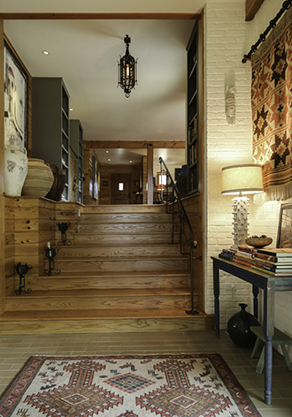 Opposite/ The house used to end at the top of these stairs. There was a 5-foot drop and then a garage. Carpenter Rick Triplet built the staircase, which now leads to a master suite. Photo by Jeanine Michna-Bales