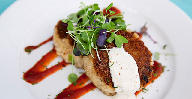 Crabcakes with micro greens and sriracha: Photo by Desiree Espada