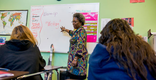 An instructor leads a lesson for teens at Promise House. Photo by Danny Fulgencio
