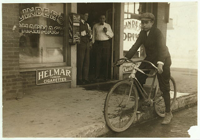 A delivery boy straddles his bike in downtown Dallas in the 1930s. Photo courtesy of the Library of Congress
