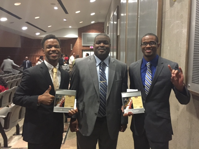South Oak Cliff High School seniors Frank Byers, left, and Alex Simmons, right, with principal Shon Joseph