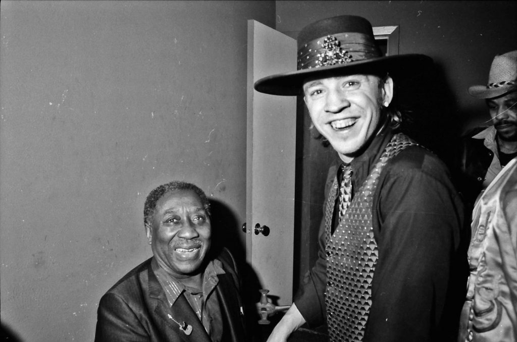 Stevie Ray Vaughan and Muddy Waters backstage at Nick's Upstairs. Photo by Kirby Warnock