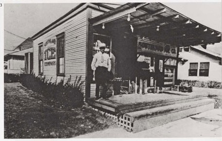 "A Southland employee stands in front of the ice dock on Edgefield at Twelfth, which would become the first 7-Eleven store. Photo courtesy of ""Oh Thank Heaven! The Story of the Southland Corporation,"" by Allen Liles"