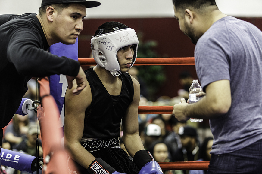 Vergil Ortiz Sr., left, and Hector Beltran Sr. give the younger Ortiz pointers during one of his bouts at the Dallas Golden Gloves in January.(Photo by Candice Chase)