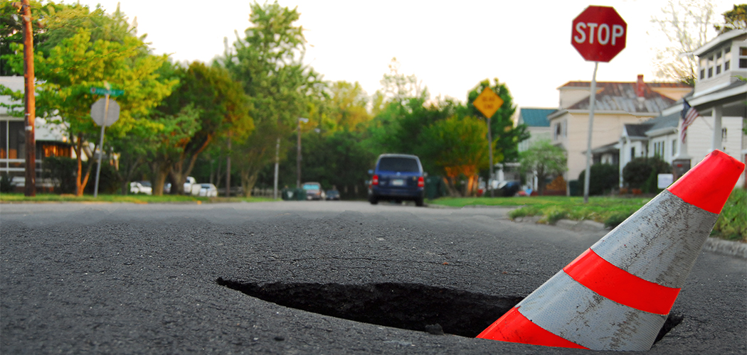 pothole with caution cone Getty