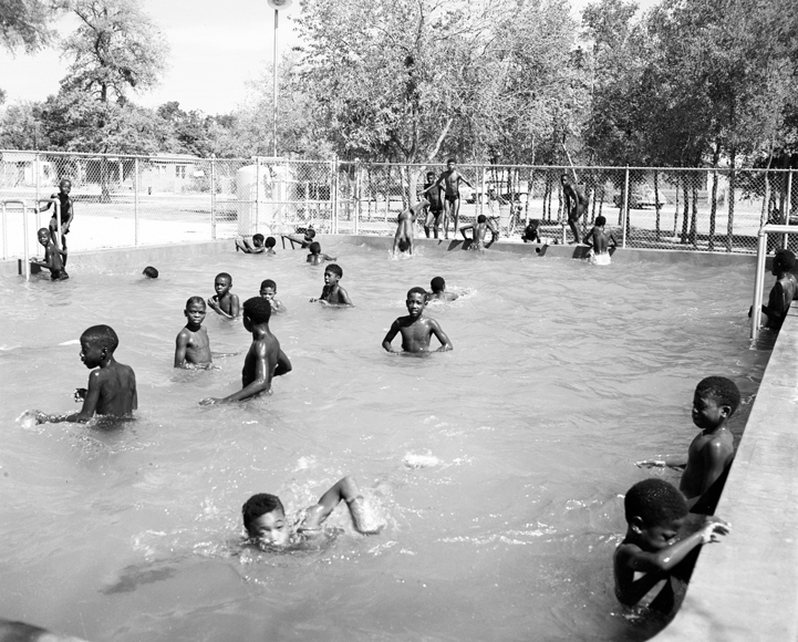 Children swim in the Exline Park pool during segregation. (Photo courtesy of the Dallas History & Archives Division, Dallas Public Library)
