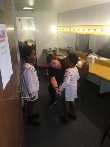 """James Hayes, 7, and Anthony Taylor, 5, are fitted for their costume as Young Coalhouse in the musical """"Ragtime."""" (Photo courtesy of Dallas Summer Musicals)"""