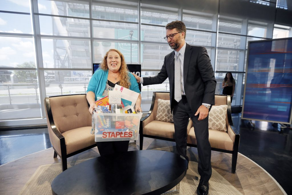 Jennifer Hatcher of Greiner middle school receives a surprise live on WFAA Tuesday morning from Staples vice president of global communications Bill Durling. Photo by Brandon Wade/AP Images for Staples