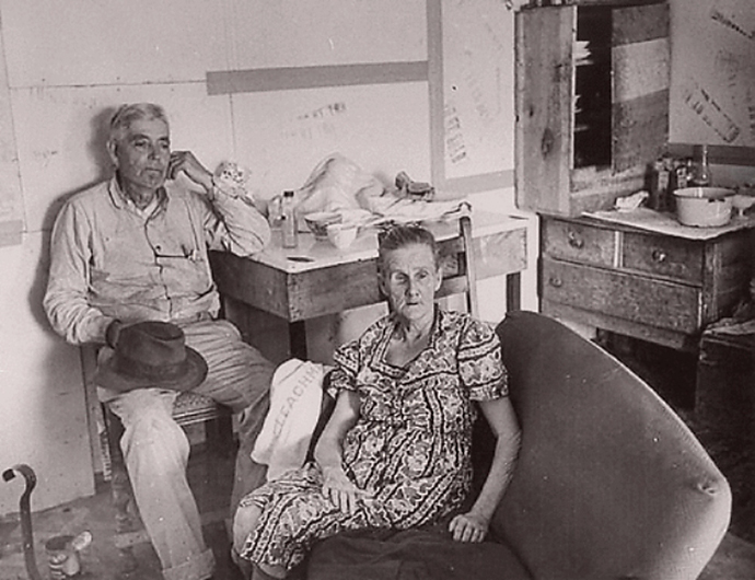 Henry and Cumie Barrow, Clyde Barrow's parents, at home. Cumie, then 65, lost her right eye to Whatley's shotgun.