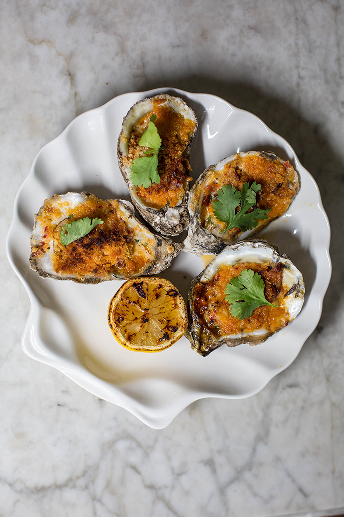 The Theodore's roasted oysters with bell-pepper butter, bacon and bread crumbs. (Photo by Kathy Tran)
