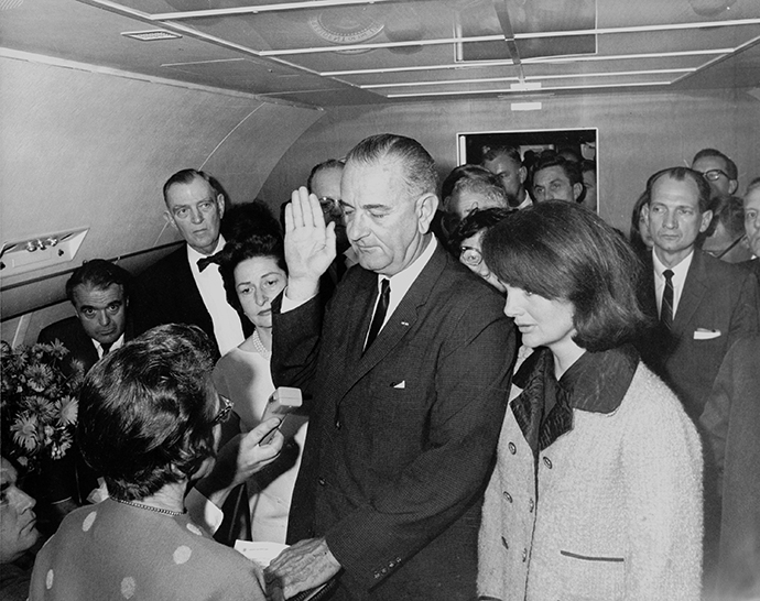 Lyndon Baines Johnson takes the oath of office aboard Air Force One at Love Field following the Kennedy Assassination.