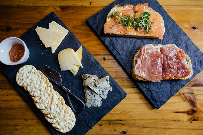 Tostas with prosciutto and smoked salmon and a cheese plate.(Photo by Kathy Tran)