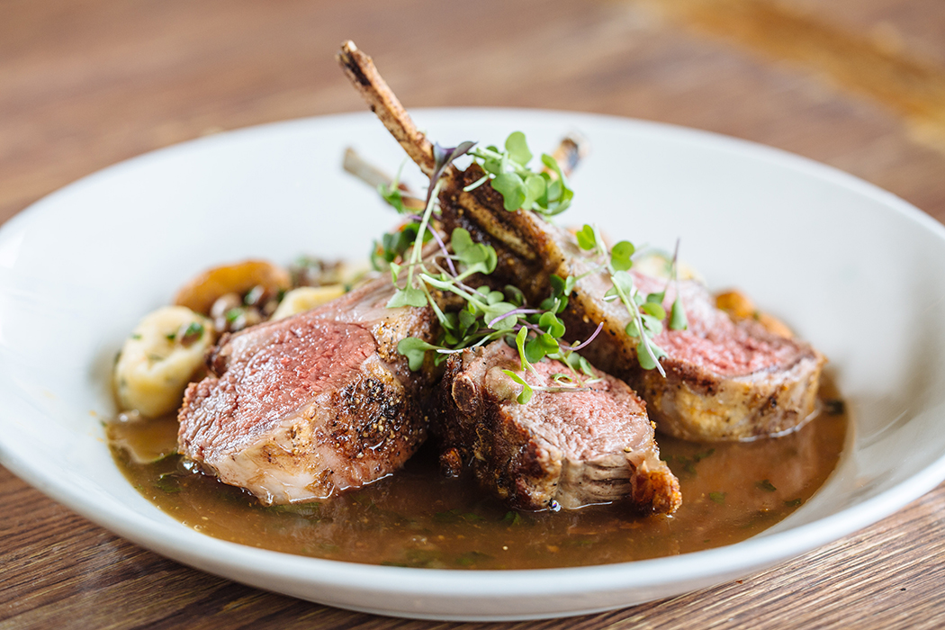 Lamb rack with goat-cheese gnocchi, pigeon peas, chanterelles and charred shallots. Photo by Kathy Tran