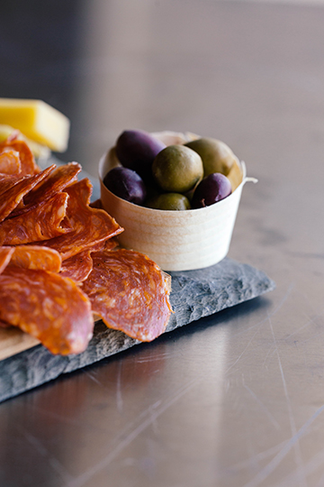 A charcuterie plate with olives. (Photo by Kathy Tran)