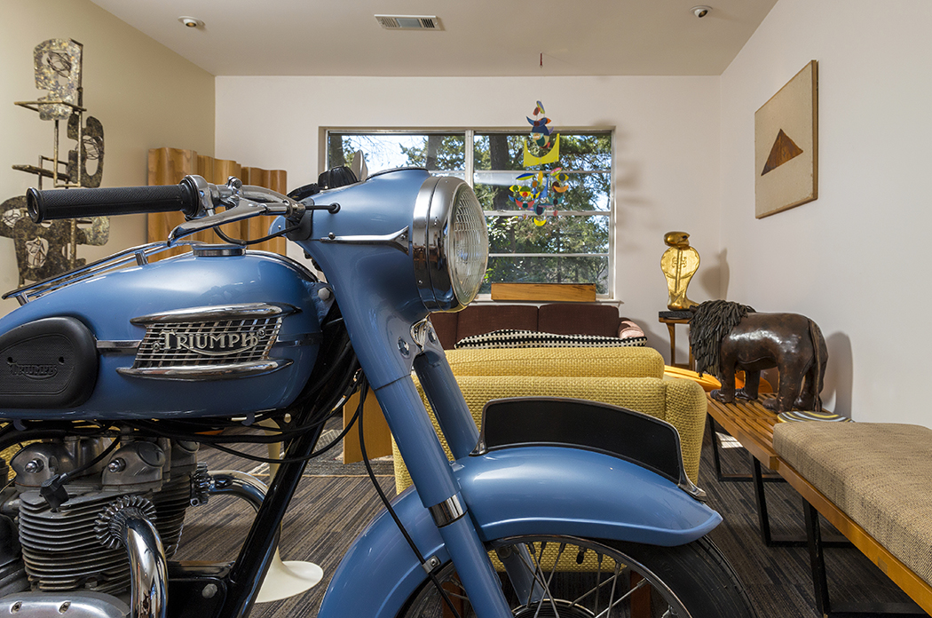 A 1956 Triumph Twenty One is one of two vintage motorcycles Gream keeps inside his house. A mid-century modern furniture dealer, Gream also collects art from that era. (Photo by Danny Fulgencio)
