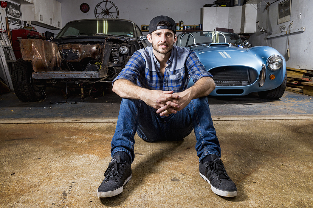 Tyler Wayne with his '68 Mercury and his Shelby Cobra reproduction. Both cars are projects Wayne worked on with his dad. (Photo by Danny Fulgencio)