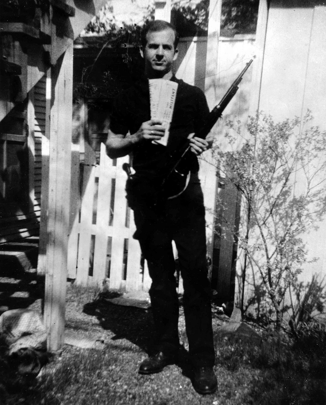 Lee Harvey Oswald in the backyard of 214 W. Neely, the duplex where he lived with wife, Marina, who took the infamous photo.(Photos courtesy of the Texas Panhandle Plains Museum, the Dallas PUblic Library and the Dallas Municipal archives)