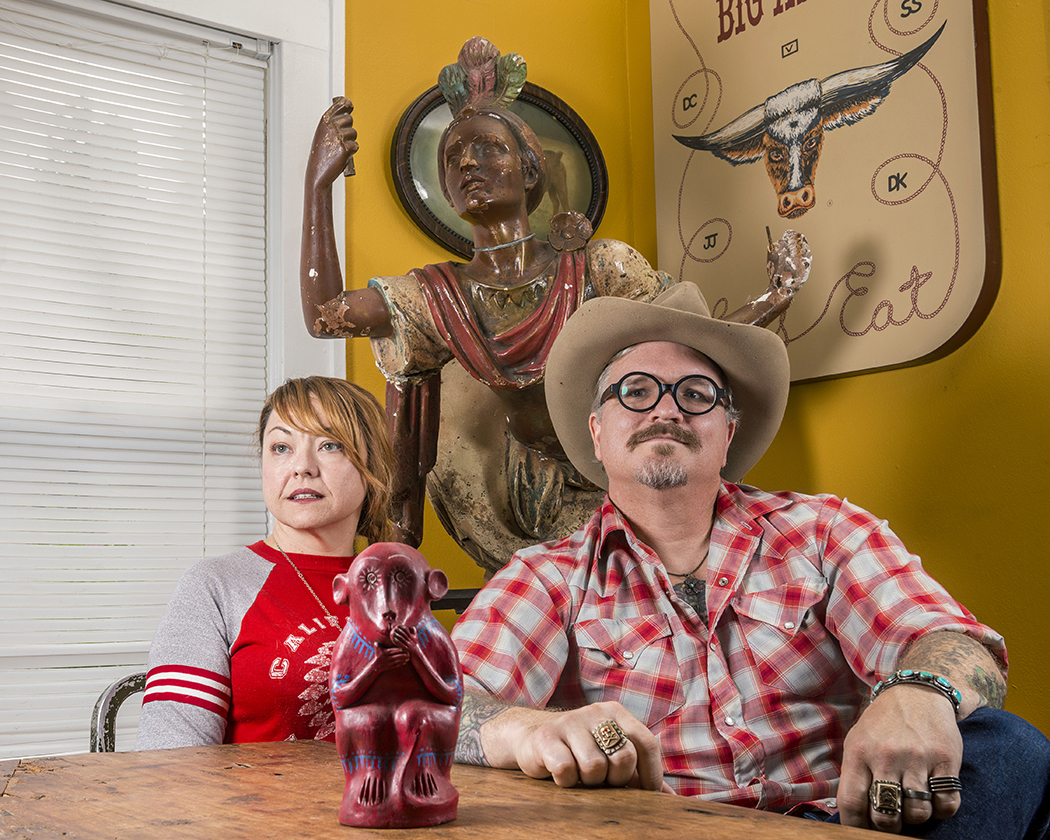 Shad Kvetko, right, is a second-generation antiques dealer who collects Mexican folk art, among many other things. His wife, Leigh, is a graphic designer who collects shoes from the 1940s. (Photo by Danny Fulgencio)