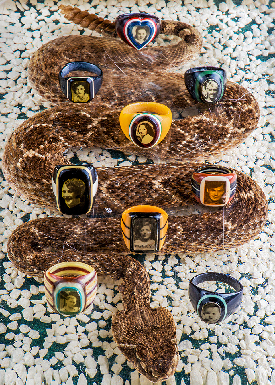 """Examples from Strickland's collection include tributes to children who died as well as """"sweetheart"""" rings and prison rings, which were crafted from Bakelite toothbrushes from behind bars. (Photos by Danny Fulgencio)"""