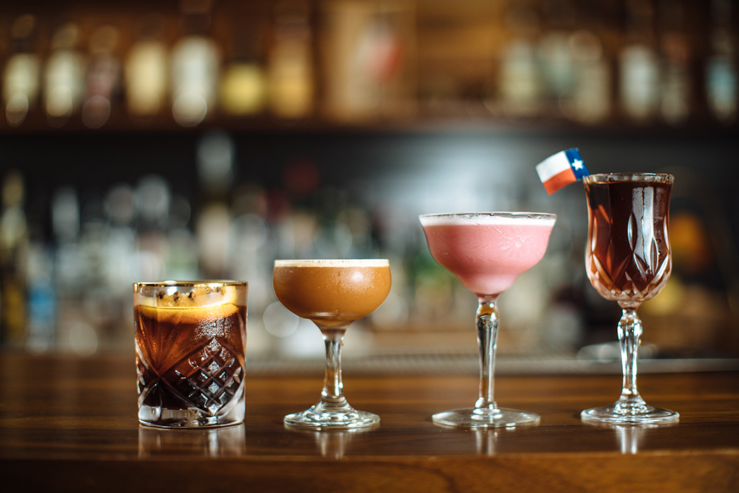 A lineup of artfully crafted cocktails: One of these nights, two-lane blacktop, pink lady and Manhattan Texas. (Photo by Kathy Tran)