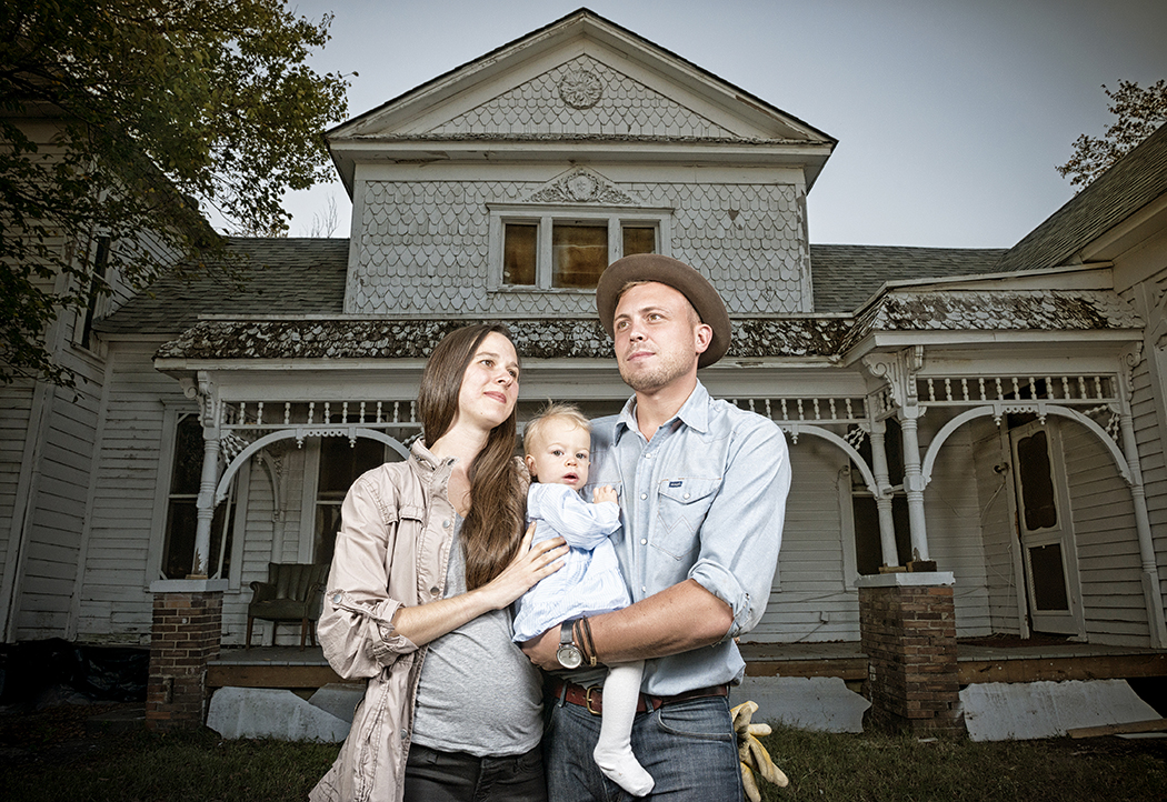 Michaella and A.J. Ramler, here with their daughter, Lucia, bought the 127-year-old Struck house in West Dallas. The Ramlers plan to renovate and live in the house, which a developer had planned to tear down earlier this year. (Photo by Danny Fulgencio)