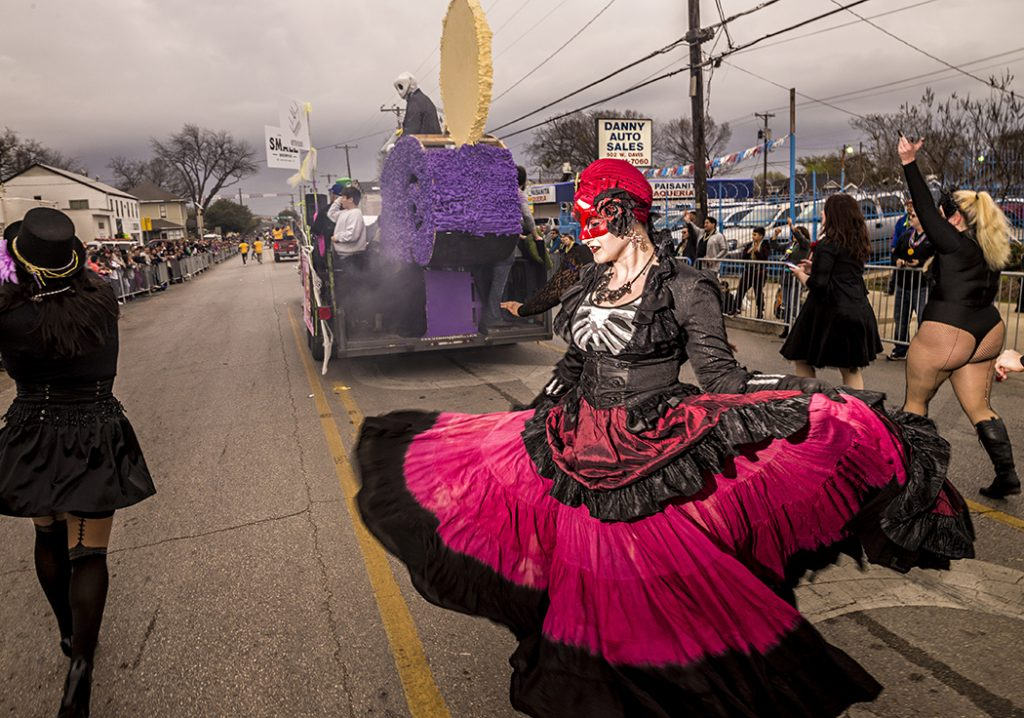 A Mardi Gras dancer twirls down West Davis during the annual Oak Cliff Mardi Gras parade in February. The parade draws thousands of people to the neighborhood and is one of the biggest events in Oak Cliff. (Photo by Danny Fulgencio)