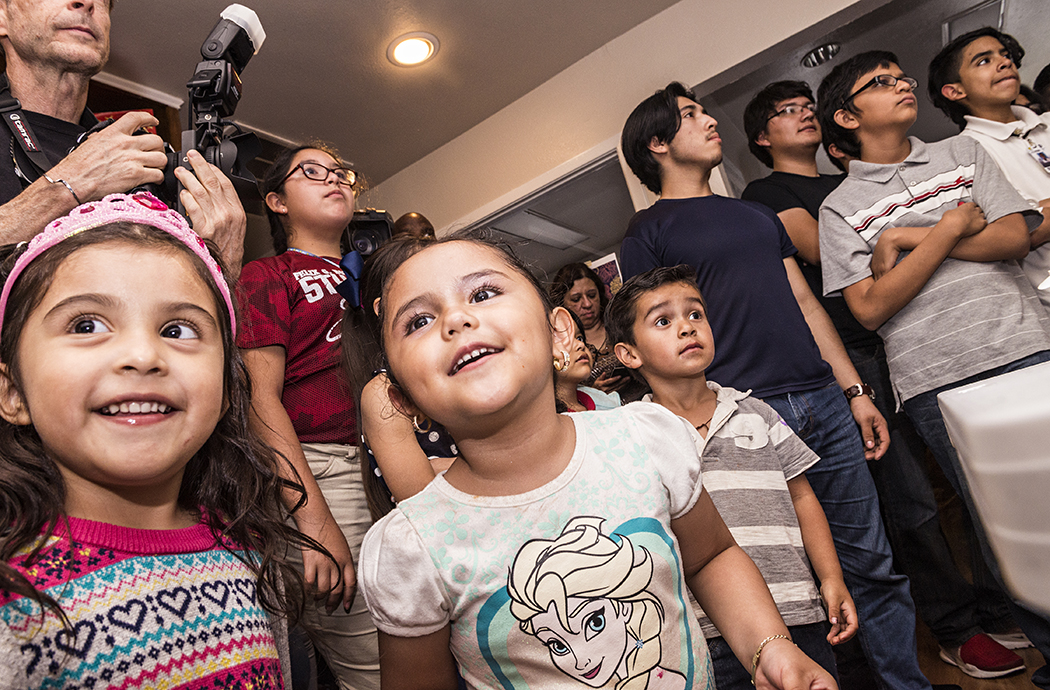 Children await the cutting of a birthday cake at La Rondalla, a nonprofit music school for elementary-high school students. Oak Cliff native Edie Brickell had played a benefit concert with the New Bohemians at the Kessler Theater in April to raise $17,000 for the school. (Photo by Danny Fulgencio)