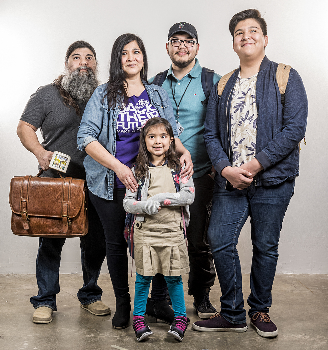 Neighborhood schools have been good to Ermin Macias and Andy Ramirez. Their 7-year-old daughter, Elise, is at Rosemont Elementary, where all their children started. Sons, Elijah, 17, and Noah, 14, chose to leave Dallas ISD's Booker T. Washington arts magnet for Sunset High School. Oldest daughter, Sophia (not pictured), was last year's Sunset valedictorian. (Photo by Danny Fulgencio)