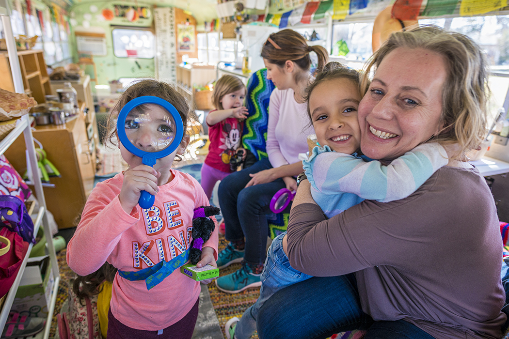 Seed Preschool teacher and owner Jennifer Stuart works with students on her moveable classrooom, a bus named Matilda. Photo by Danny Fulgencio