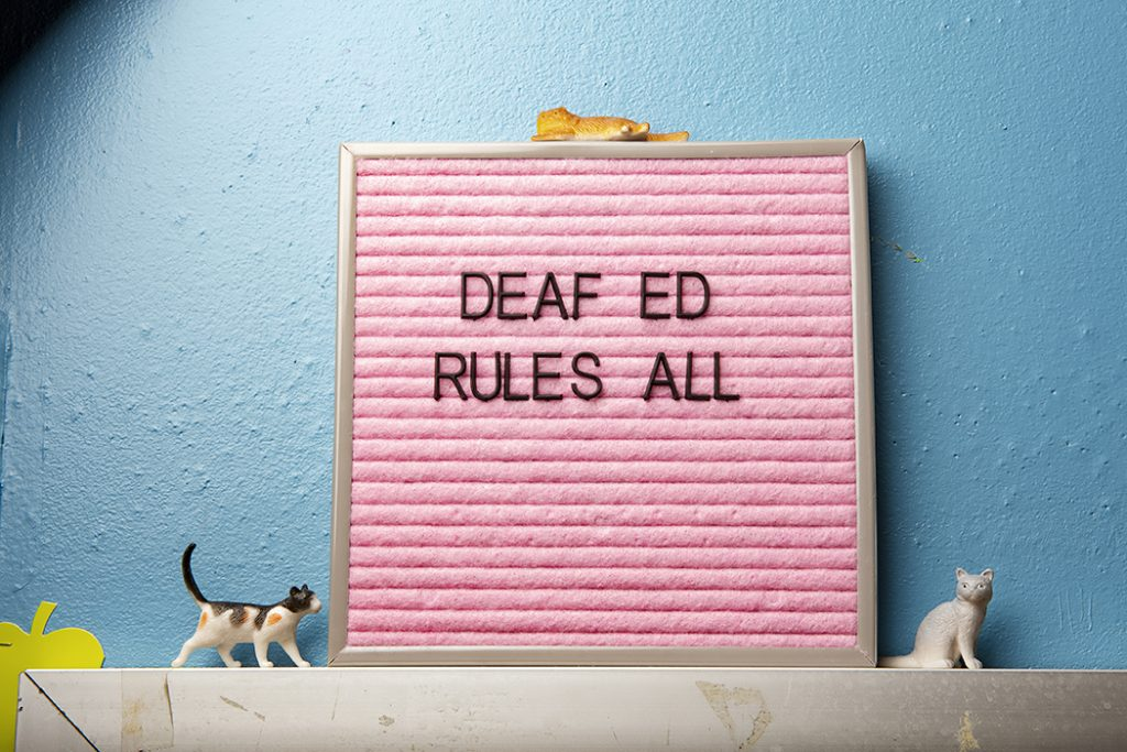 """Sign in classroom that reads """"Deaf Ed Rules All"""""""